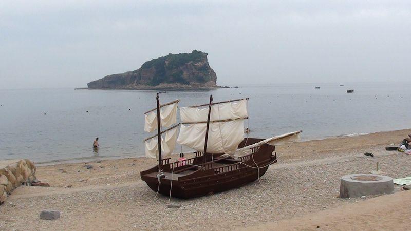 Пляж Очарование моря. Далянь